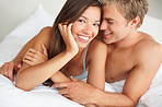 Happy intimate couple having fun in bed