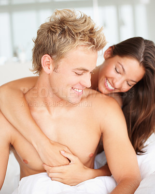 Buy stock photo Couple embracing on bed after waking up in the morning