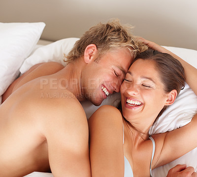 Buy stock photo Lovely young couple having fun in the bedroom
