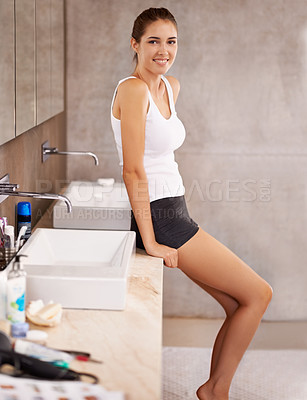 Buy stock photo Portrait of a beautiful young woman standing in her bathroom