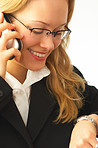 Happy young businesswoman talking making a call