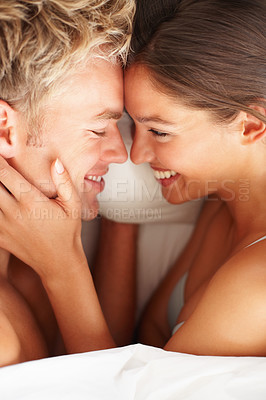 Buy stock photo Closeup of a young couple enjoying themselves on bed