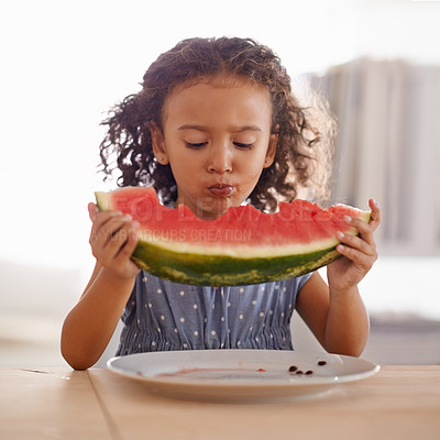 Buy stock photo Shot of a cute little girl eating watermelon