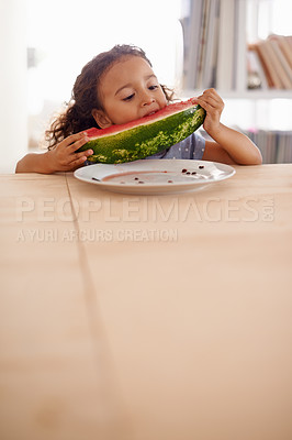 Buy stock photo Shot of a cute little girl eating watermelon at a dining table