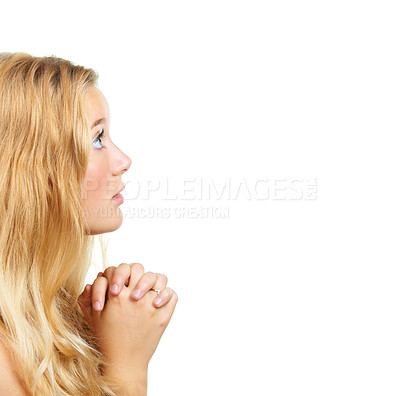 Buy stock photo Shot of an attractive young woman praying against a white background