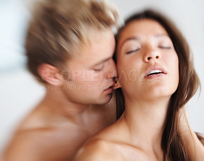Buy stock photo Intimate young couple indulging in sexual intercourse