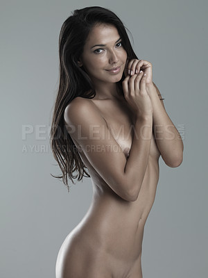 Buy stock photo Stuido portrait of a sexy naked woman against a gray background