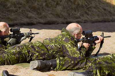 Buy stock photo Rearview shot of soldiers practicing sharpshooting