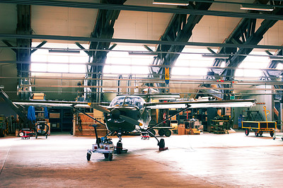 Buy stock photo Shot of a light aircraft in a hanger