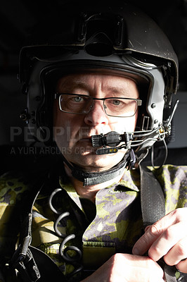 Buy stock photo Portrait of a pilot in his aircraft wearing a helmet with a communication device