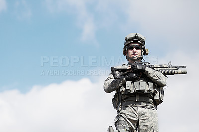 Buy stock photo Cropped image of a soldier holding a gun
