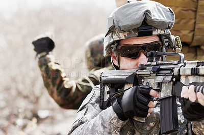 Buy stock photo Cropped shot of a military sniper taking aim]