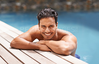 Buy stock photo Portrait of a handsome young man sitting in a pool