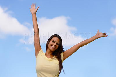 Buy stock photo Shot of a woman enjoying the outdoors with her arms raised to the sky