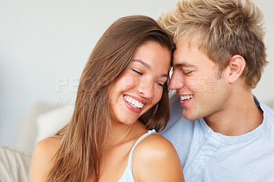 Buy stock photo Portrait of a happy couple laughing