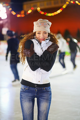 Buy stock photo Portrait of a beautiful young woman standing in an ice rink