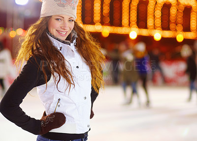Buy stock photo Portrait of a young woman standing in an ice rink