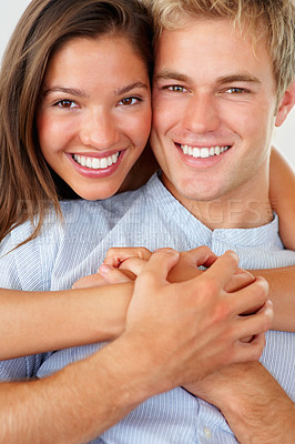 Buy stock photo Happy young man holding his girlfriend