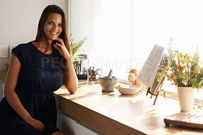 Buy stock photo Cropped shot of a beautiful woman standing in her kitchen a home