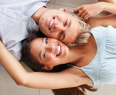 Buy stock photo Top view of a lovely couple lying on the floor with their face close together
