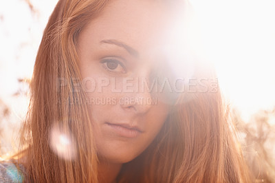 Buy stock photo Close up shot of a lovely redhead outdoors smiling at the camera