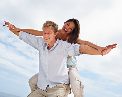Buy stock photo Portrait of a young man and his girlfriend stretching their hands together