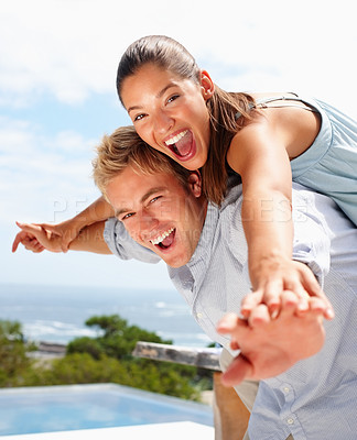 Buy stock photo Closeup portrait of a young man and his girlfriend stretching their hands together