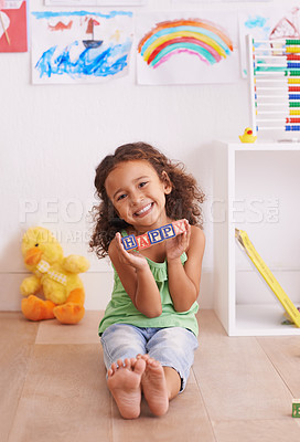 Buy stock photo Shot of a cute little girl playing with alphabet blocks