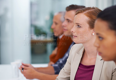 Buy stock photo A group of business people listening to a presentation at a seminar