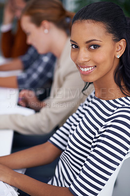 Buy stock photo Portrait of an attractive young woman with her colleagues in the background