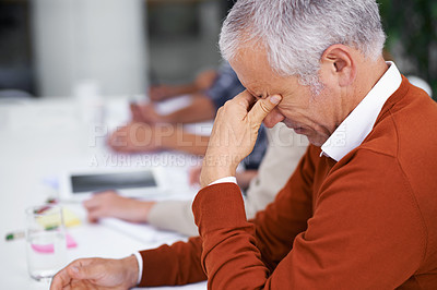 Buy stock photo Cropped shot of a mature businessman looking stressed