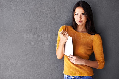 Buy stock photo Portrait of an attractive young woman holding a digital tablet