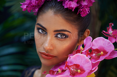 Buy stock photo A portrait of a beautiful woman wearing colorful flowers
