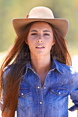Buy stock photo Closeup of a young cowgirl enjoying the outdoors