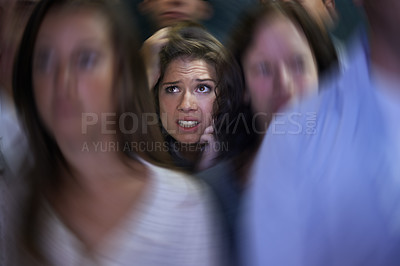 Buy stock photo Shot of a fearful young woman feeling trapped by the crowd