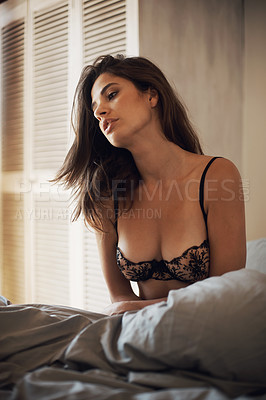 Buy stock photo Shot of a beautiful woman sitting up in bed