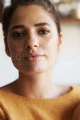 Buy stock photo A cropped portrait of a beautiful young woman with her hair tied back