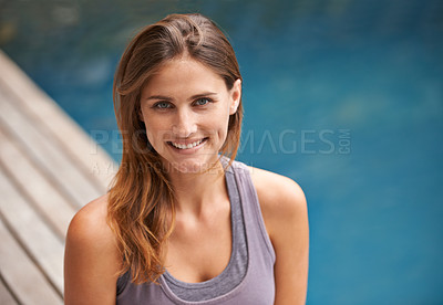 Buy stock photo Closeup portrait of cute young female sitting by the swimming pool
