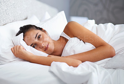Buy stock photo Cropped shot of a beautiful young woman resting in bed