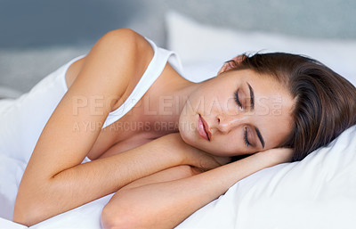 Buy stock photo A beautiful young woman sleeping in her bedroom