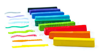Buy stock photo A line of chalk in many colors on a white background