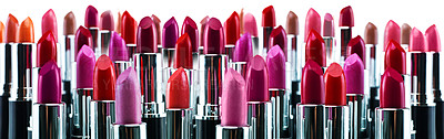 Buy stock photo A studio shot of many different colored lipsticks