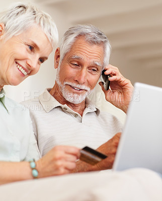Buy stock photo Happy couple speaking to a booking office and shopping from the net