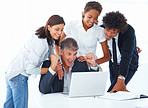 Team of excited business colleagues working together on a laptop