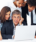 A shocked business team working together on a laptop