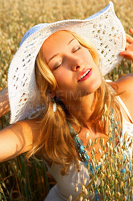 Buy stock photo Portrait of serenely beautiful woman basking in sunlight in a field of summer grass