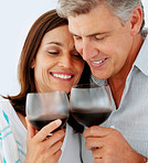 Closeup of a happy mature couple drinking a glass of wine together