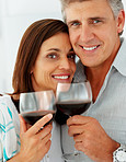 Closeup of a cute mature couple drinking a glass of wine together
