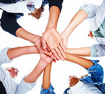 Upward view of a team of people with their hands together on a white background