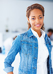 Young charming African woman wearing a denim jacket and smiling
